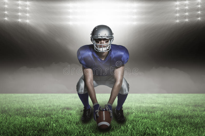 Composite image of american football player with ball crouching with 3d. American football player with ball crouching against spotlight with copy space 3d stock images