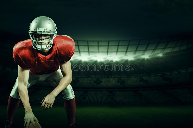Composite image of american football player holding helmet royalty free stock photos