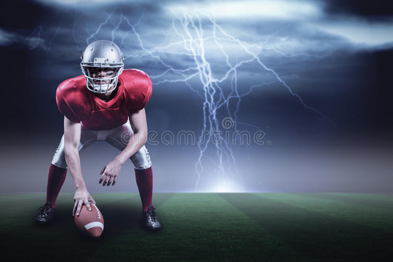 Composite image of american football player holding helmet with 3d. American football player holding helmet against stormy dark sky with lightning bolts with royalty free stock image