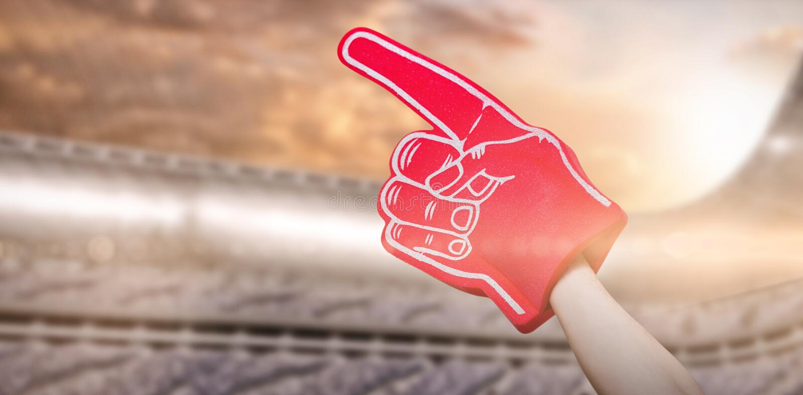 Composite image of american football player holding supporter foam hand 3d vector illustration