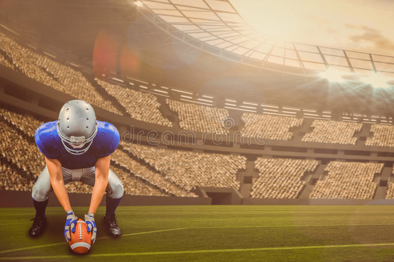 Composite image of american football player placing ball 3d. American football player placing ball against large football stadium with lights with copy space 3d stock photos