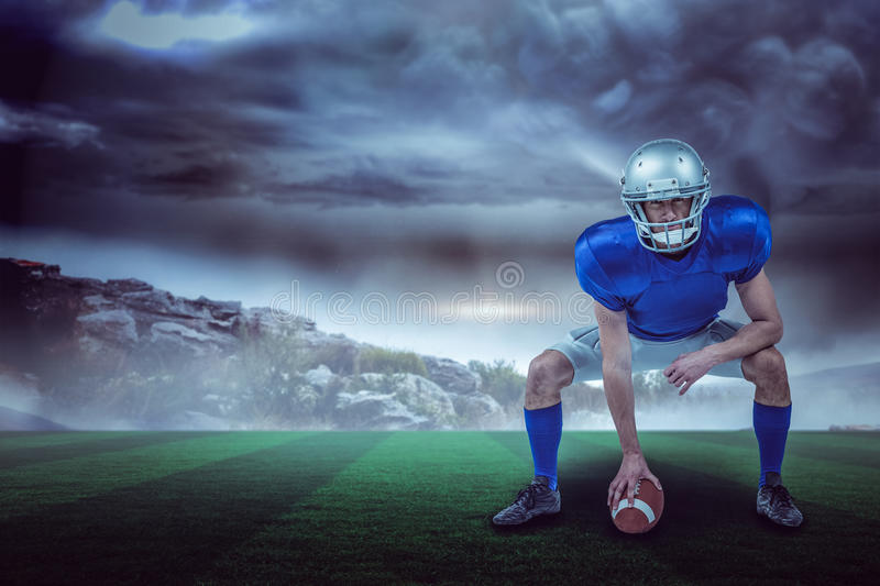 Composite image of american football player placing ball 3d. American football player placing ball against stormy sky with tornado over landscape with copy space stock images