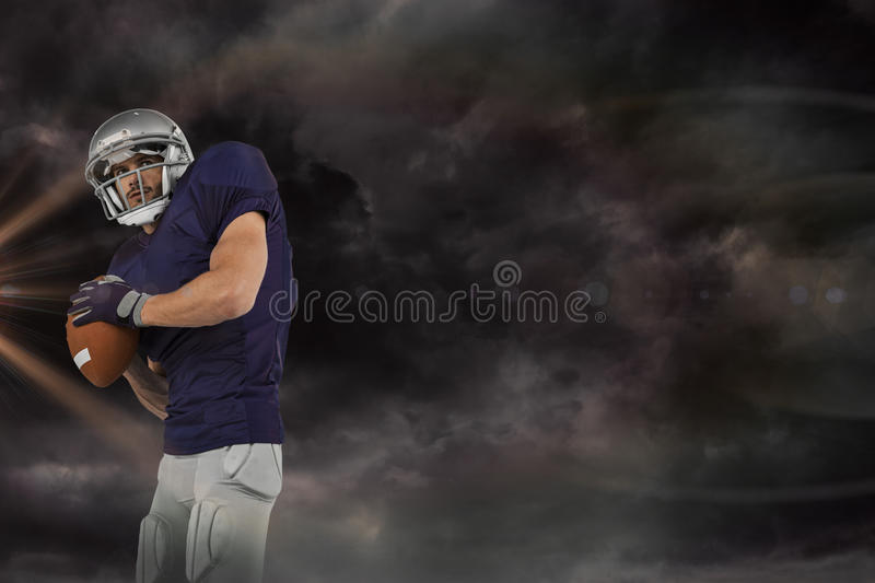 Composite image of american football player throwing ball stock photo