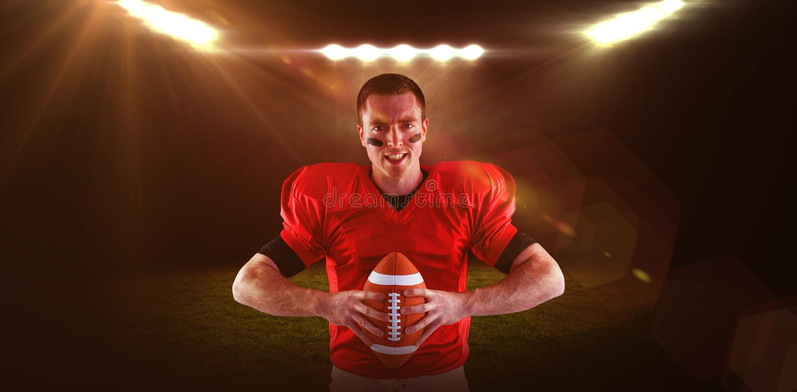 Composite image of american football player about to throw the ball stock image