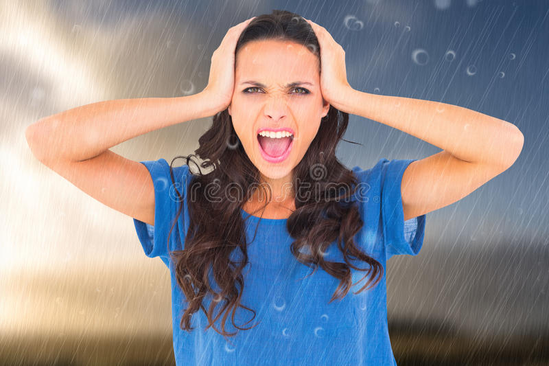 Composite image of angry brunette shouting at camera royalty free stock photography