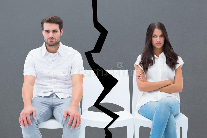 Composite image of angry couple not talking after argument. Angry couple not talking after argument against grey royalty free stock images