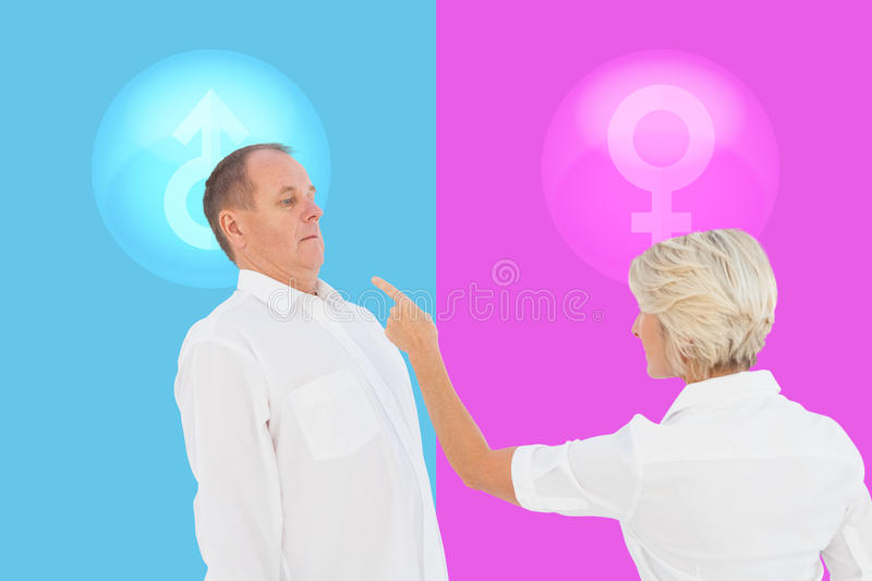 Composite image of angry older couple arguing with each other. Angry older couple arguing with each other against pink and blue stock photography