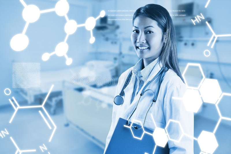 Composite image of asian doctor holding blue binder royalty free stock images