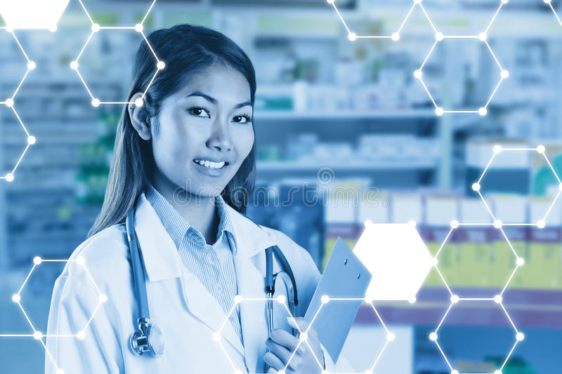 Composite image of asian doctor holding clipboard royalty free stock photo