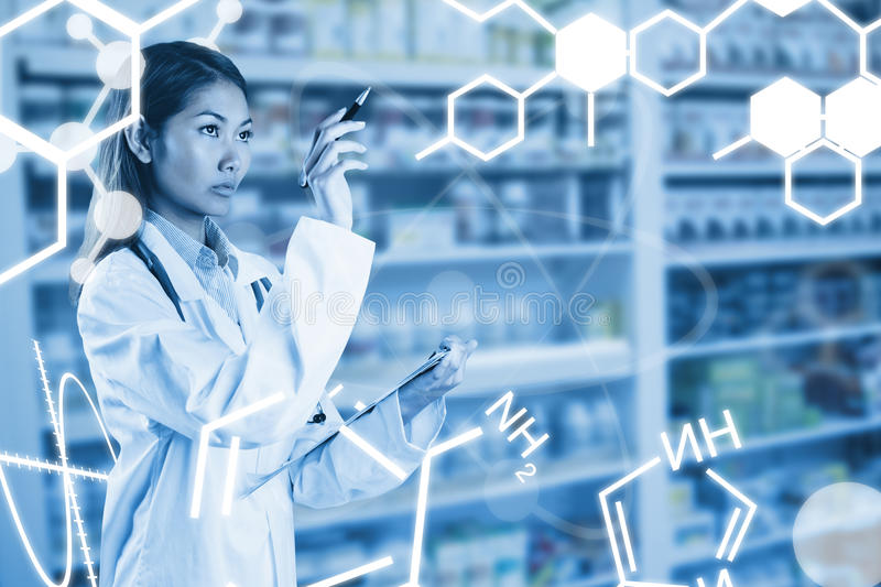 Composite image of asian doctor pointing with pen stock images