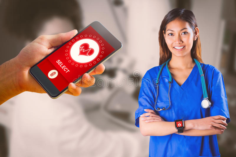 Composite image of asian nurse with stethoscope crossing arms. Asian nurse with stethoscope crossing arms against biochemistry student using large microscope stock images