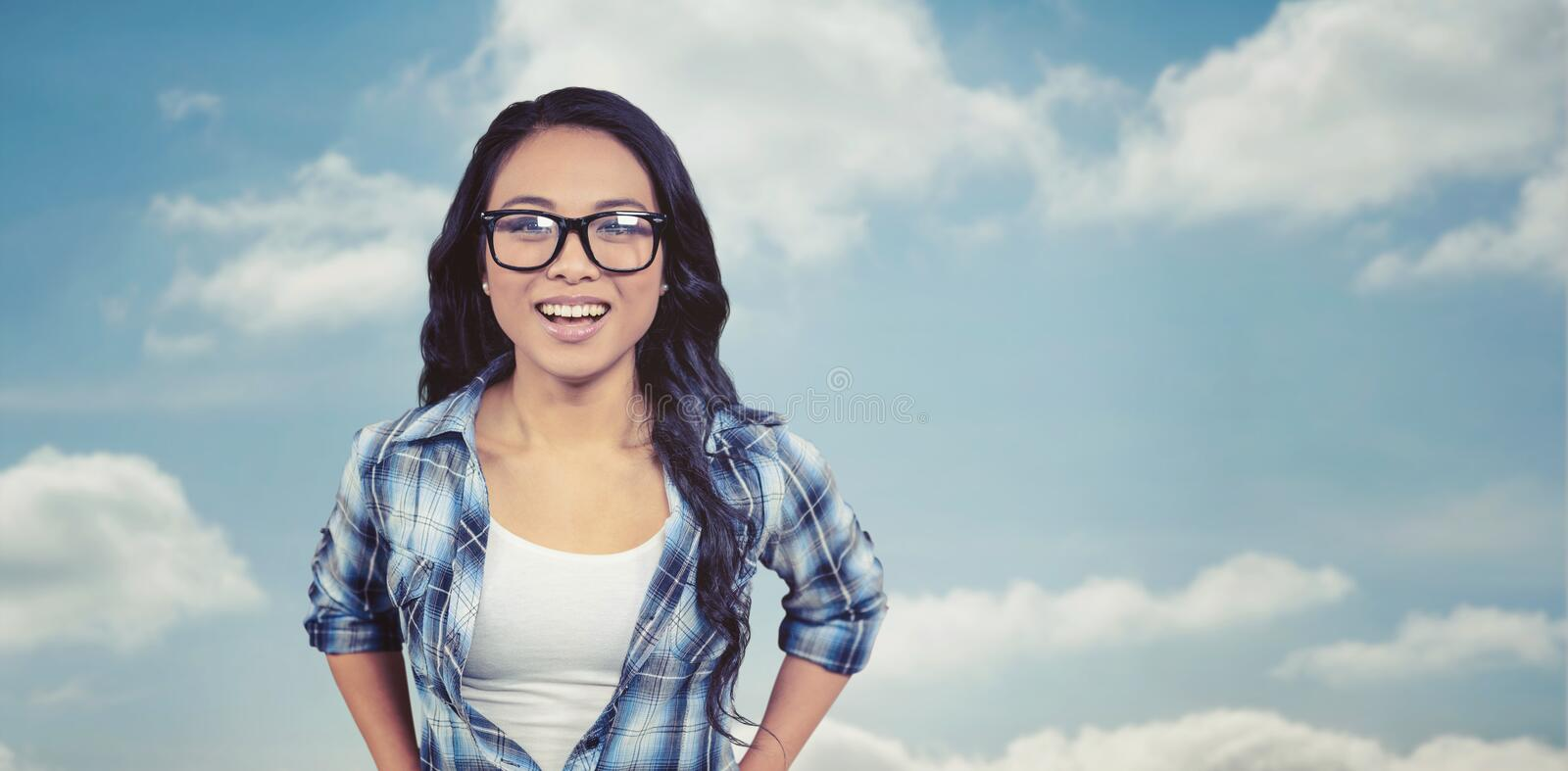 Composite image of asian woman smiling to the camera stock image