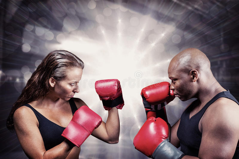Composite image of athletes with fighting stance stock images