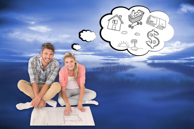 Composite image of attractive young couple sitting looking at download composite image of attractive young couple sitting looking at blueprint stock image image of malvernweather Choice Image