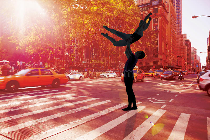 Composite image of ballet partners dancing gracefully together royalty free stock photo