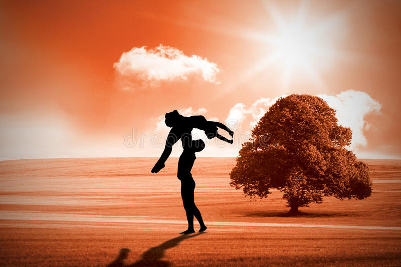Composite image of ballet partners dancing gracefully together royalty free stock image