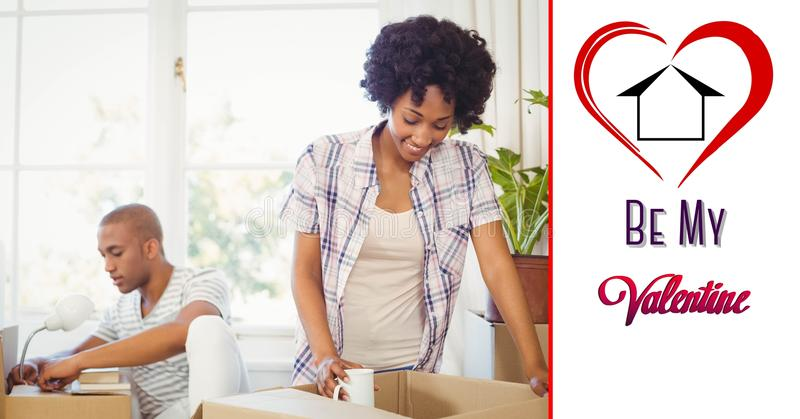 Composite image of be my valentine text with couple unpacking boxes royalty free stock images