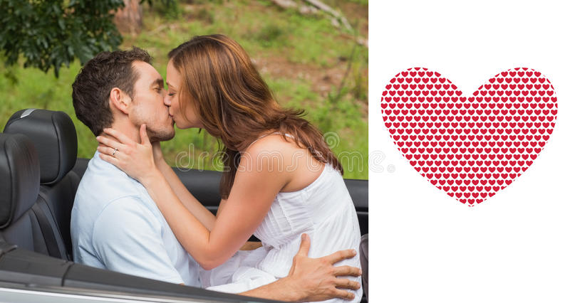 Composite image of beautiful couple kissing in back seat. Beautiful couple kissing in back seat against valentines day pattern royalty free illustration