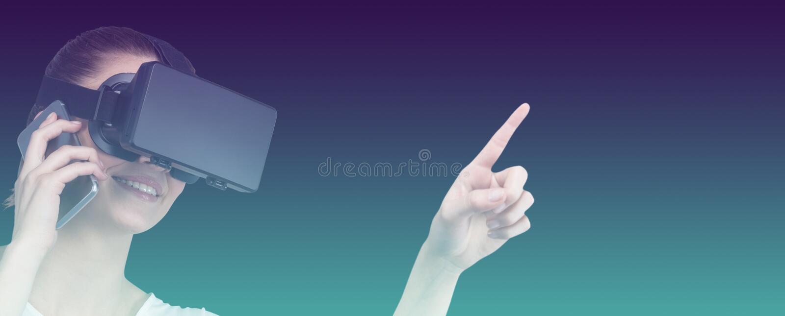 Composite image of beautiful woman gesturing while suing virtual reality headset and talking mobile royalty free stock photo