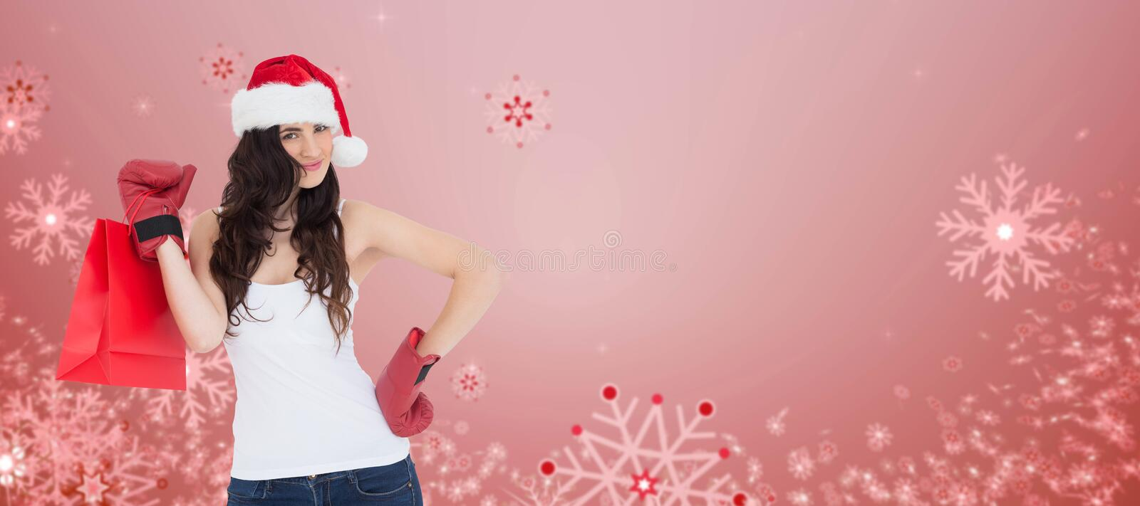 Composite image of beauty brunette in boxing gloves with shopping bag stock photo