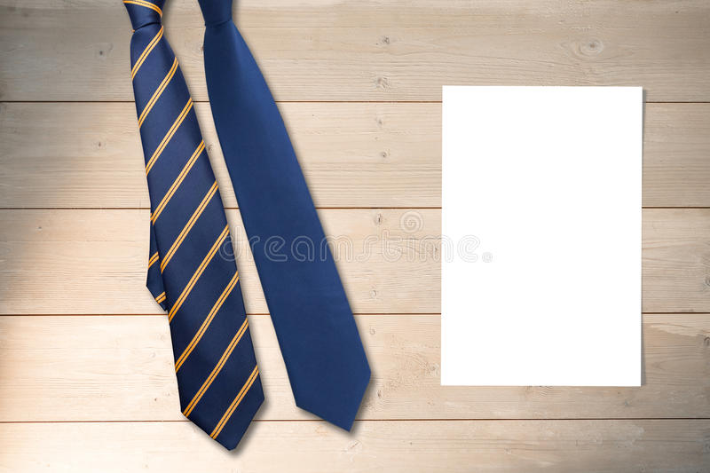 Composite image of blue tie. Blue tie against white card stock images