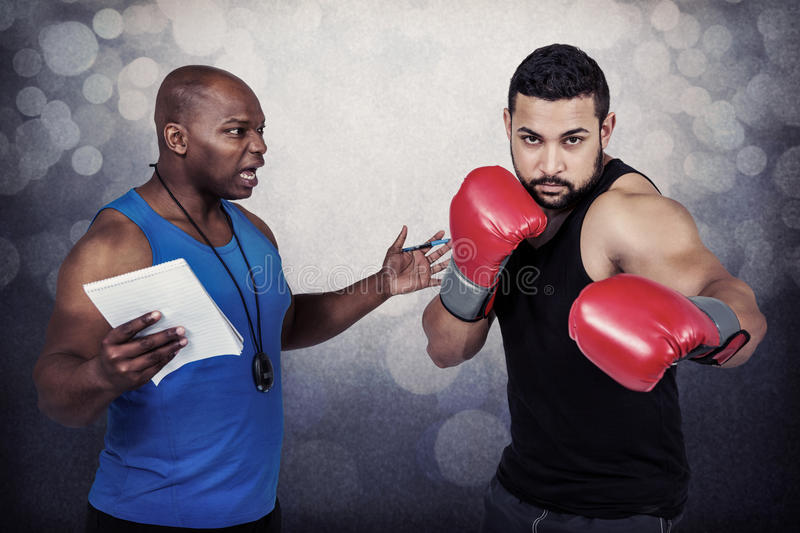 Composite image of boxing coach with his fighter royalty free stock image