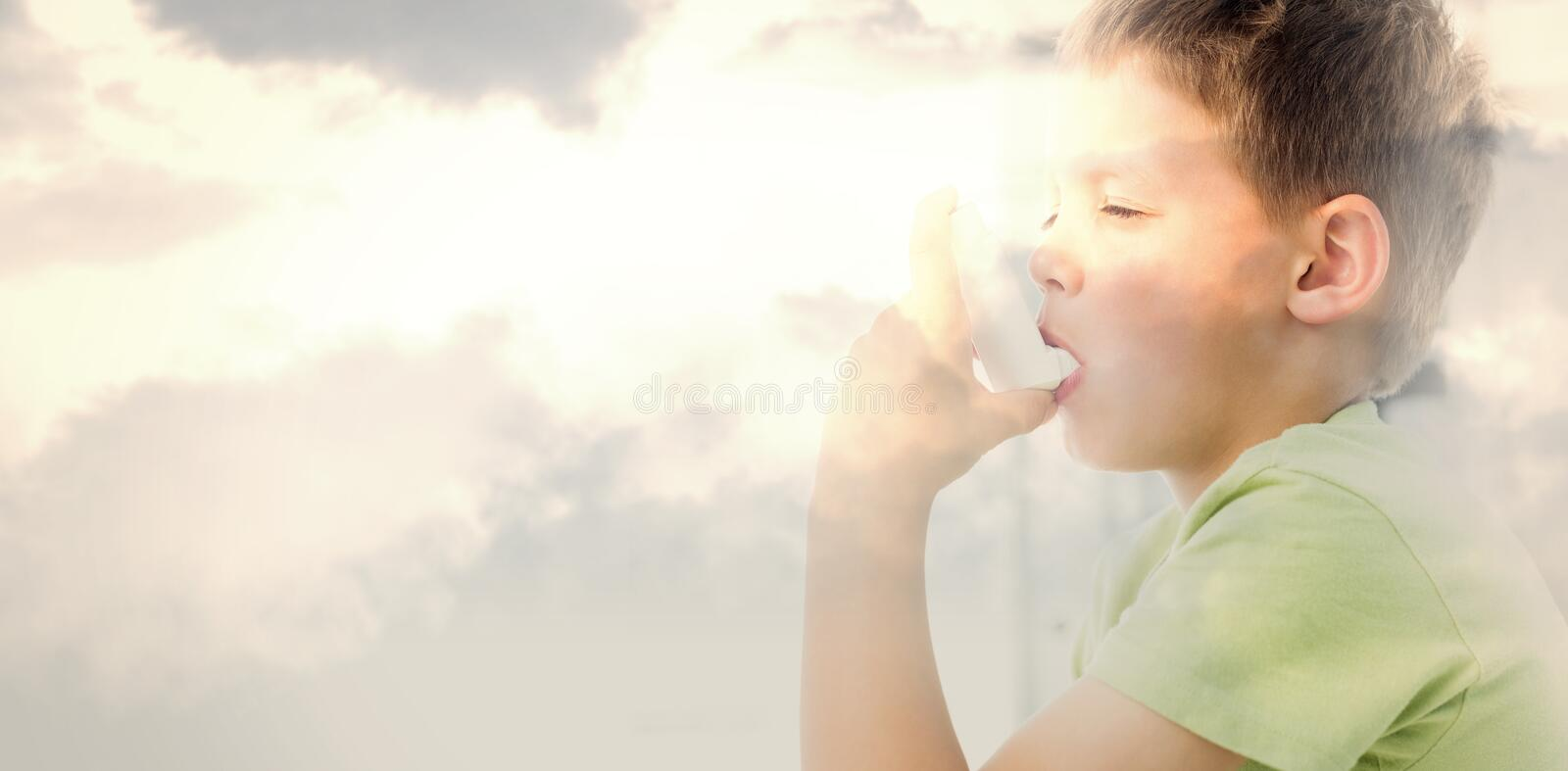Composite image of boy using an asthma inhaler in clinic royalty free stock image