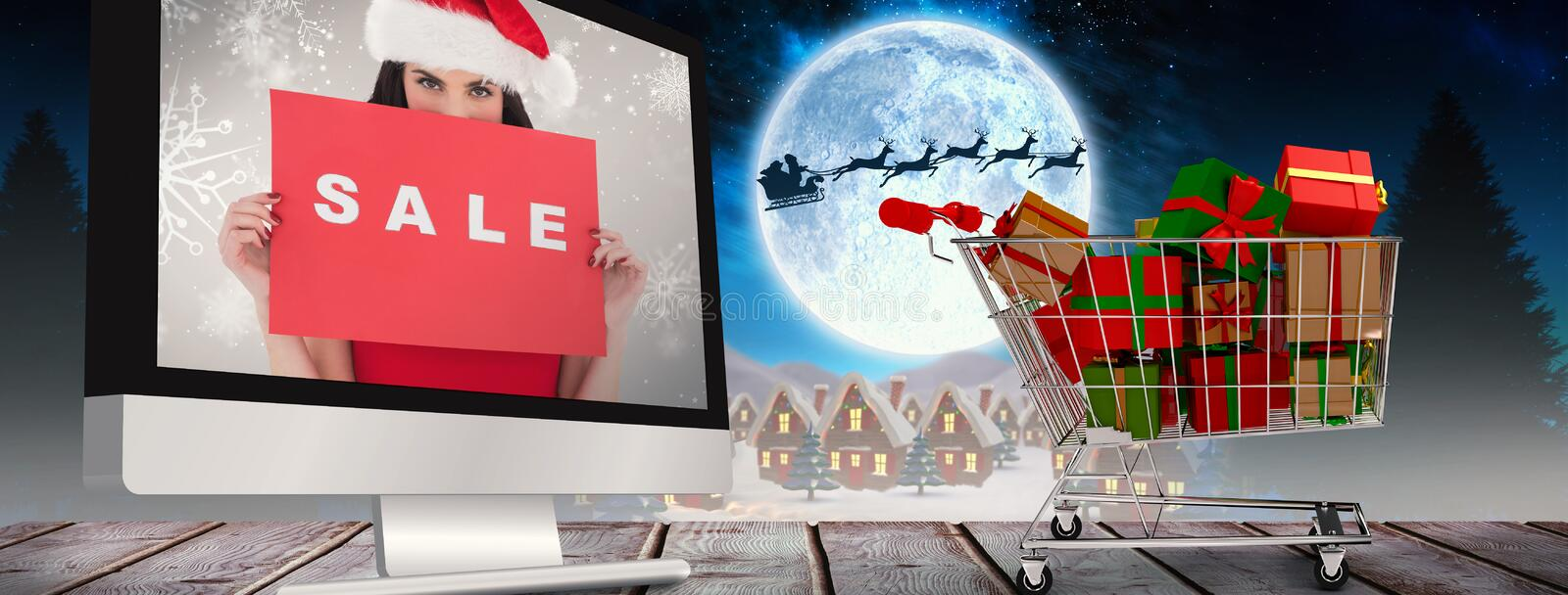 Composite image of brunette in red dress holding sale sign royalty free stock image