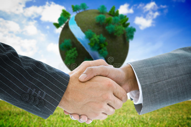 Composite image of business handshake. Against futuristic earth floating in air royalty free stock images