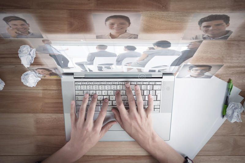 Composite image of business people having a meeting. Business people having a meeting against men working on laptop at desk in office royalty free stock images