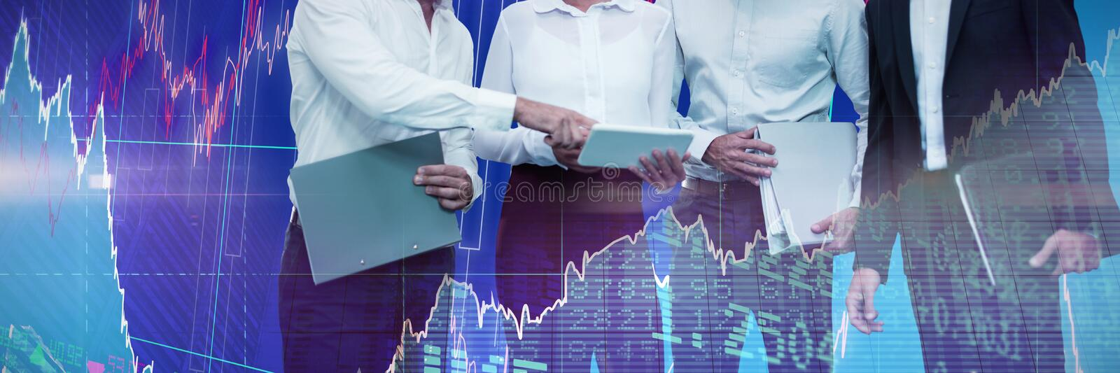 Composite image of business people holding files discussing over tablet royalty free stock image