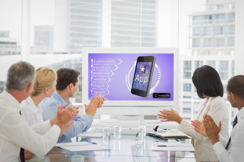 Composite image of business team clapping during a conference. Business team clapping during a conference against ad for a new application royalty free stock image