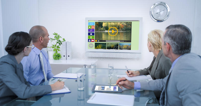 Composite image of business team looking at time clock royalty free stock photos