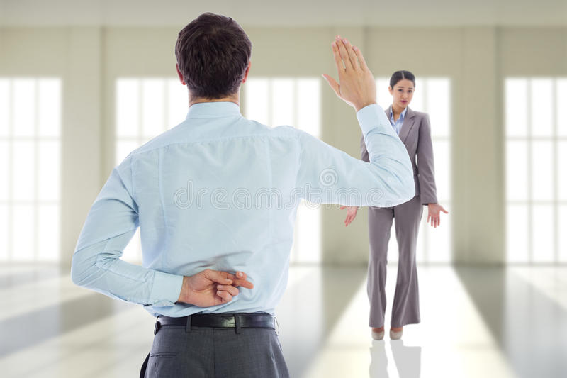 Composite image of businessman crossing fingers behind his back stock images