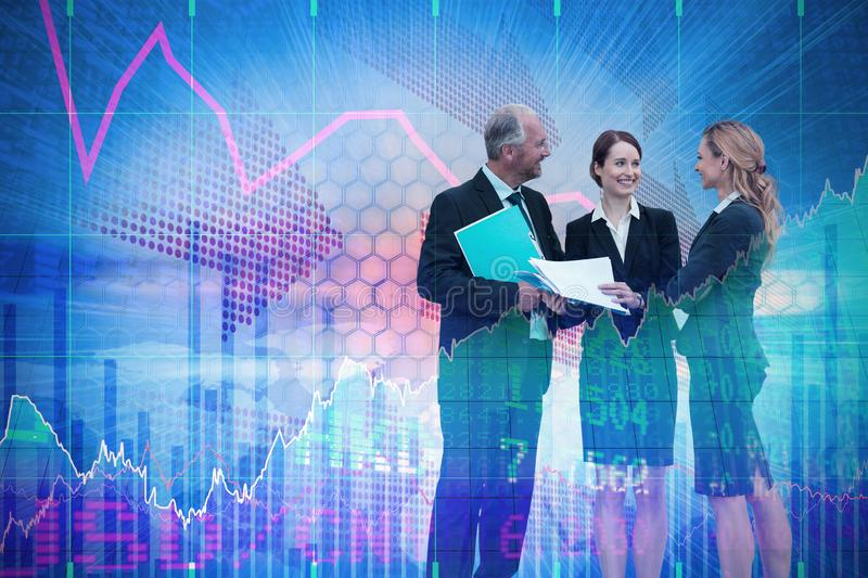Composite image of businessman discussing with female colleagues standing against white backfround royalty free stock images