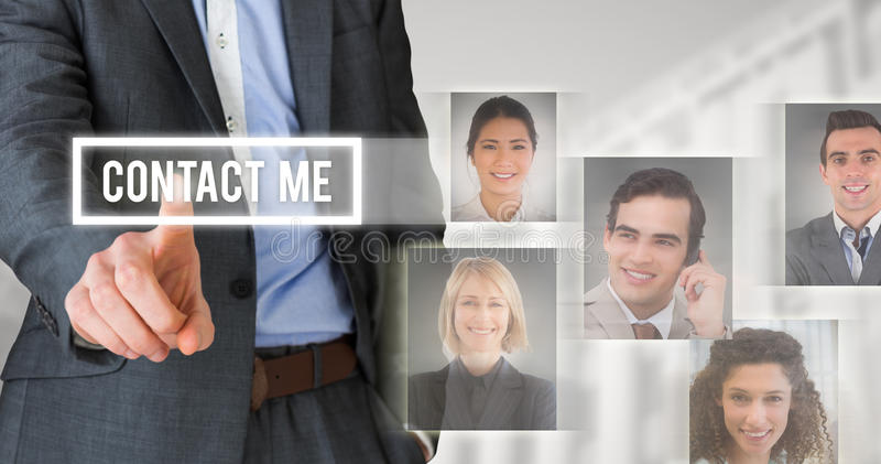 Composite image of businessman in grey suit pointing stock photography