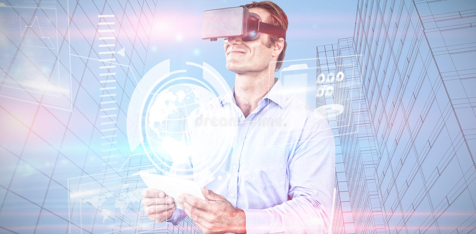 Composite image of businessman holding tablet while wearing vr glasses stock photos