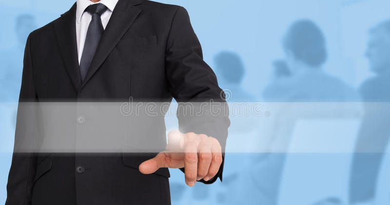 Composite image of businessman pointing stock photo