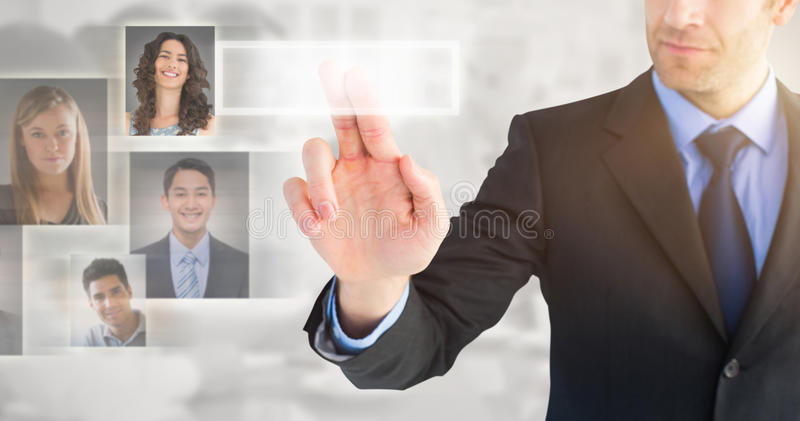 Composite image of businessman pointing these fingers at camera stock image