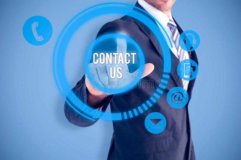 Composite image of businessman pointing with his finger. Businessman pointing with his finger against blue royalty free stock image