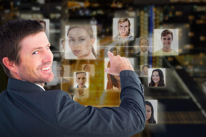 Composite image of businessman pointing with his finger stock photos