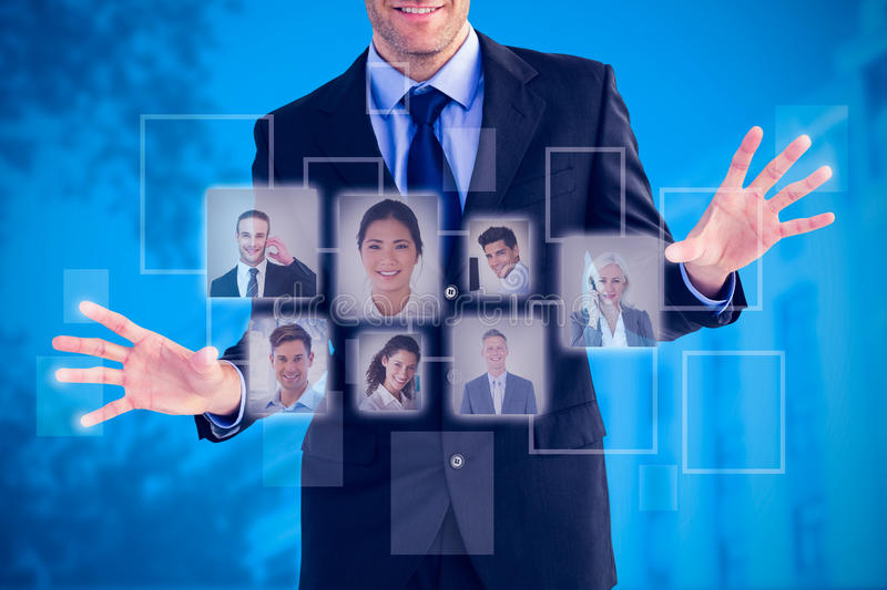 Composite image of businessman standing with fingers spread out stock photo