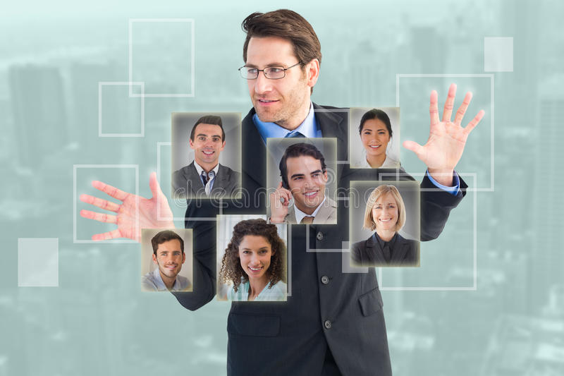 Composite image of businessman standing with fingers spread out stock photos