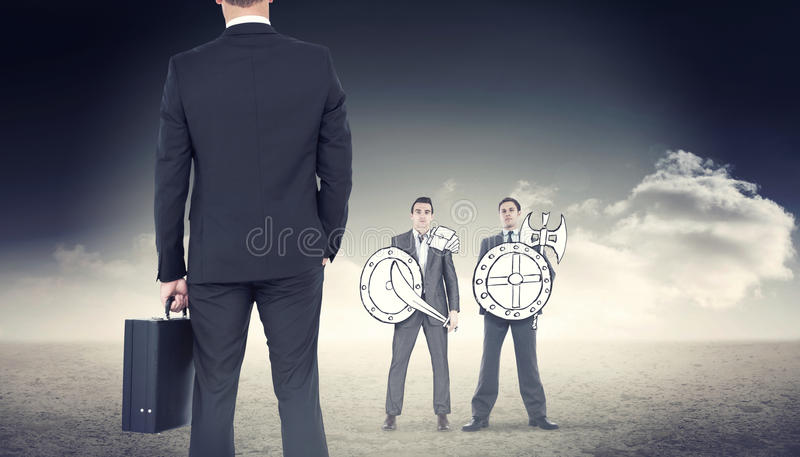 Composite image of businessman standing with his briefcase royalty free stock photo