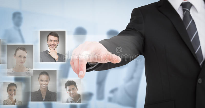 Composite image of businessman in suit pointing his finger royalty free stock image