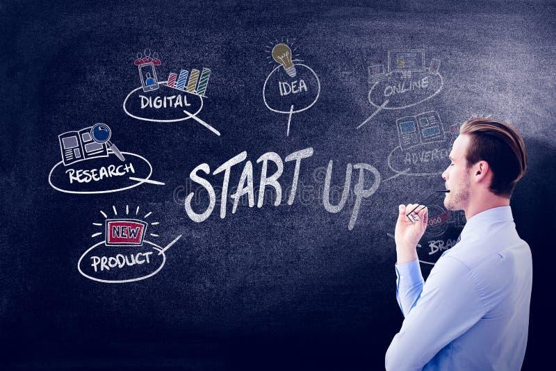 Composite image of businessman thinking. Businessman thinking against black background stock photo