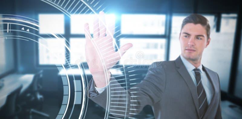 Composite image of businessman using futuristic digital screen royalty free stock image