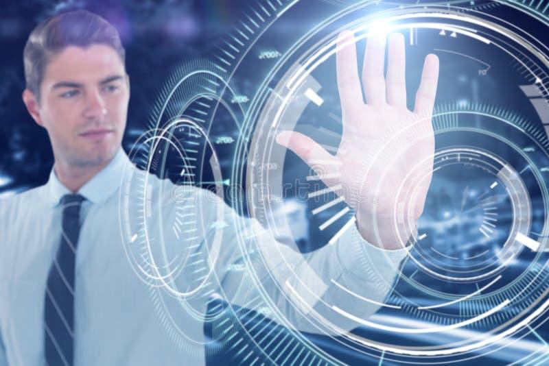 Composite image of businessman using futuristic digital screen royalty free stock photo