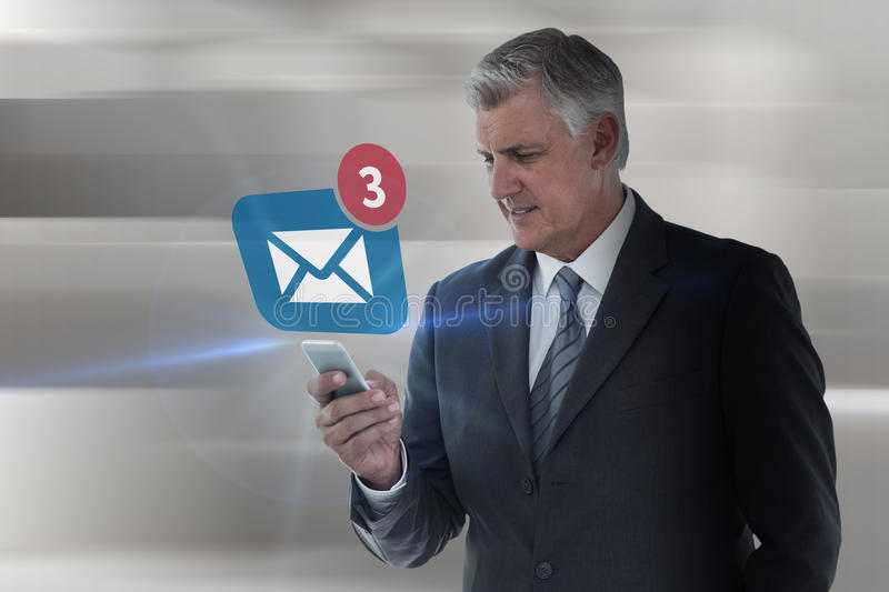 Composite image of businessman using his smartphone. Businessman using his smartphone against abstract white design royalty free stock photo