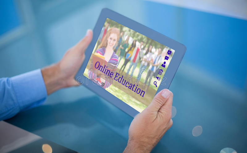 Composite image of businessman using his tablet royalty free stock photography